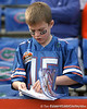 A Florida fan reads the game program before the Gators' 37-10 win against Florida State on Saturday, November 28, 2009 at Ben Hill Griffin Stadium in Gainesville, Fla. / Gator Country photo by Tim Casey