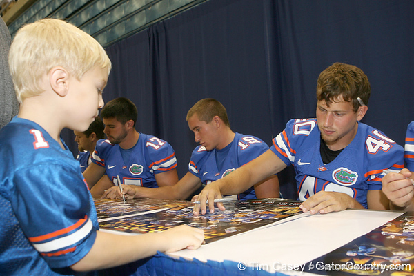 Florida redshirt sophomore punter David Lerner signs an autograph during the Gators' annual Fan Day on Sunday, August 15, 2010 at the Stephen C. O'Connell Center in Gainesville, Fla. / Gator Country photo by Tim Casey