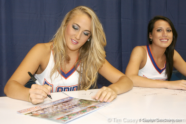 A Florida Dazzler signs an autograph during the Gators' annual Fan Day on Sunday, August 15, 2010 at the Stephen C. O'Connell Center in Gainesville, Fla. / Gator Country photo by Tim Casey