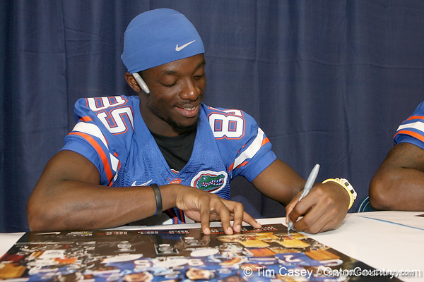 Florida redshirt sophomore wide receiver Frankie Hammond, Jr. signs an autograph during the Gators' annual Fan Day on Sunday, August 15, 2010 at the Stephen C. O'Connell Center in Gainesville, Fla. / Gator Country photo by Tim Casey
