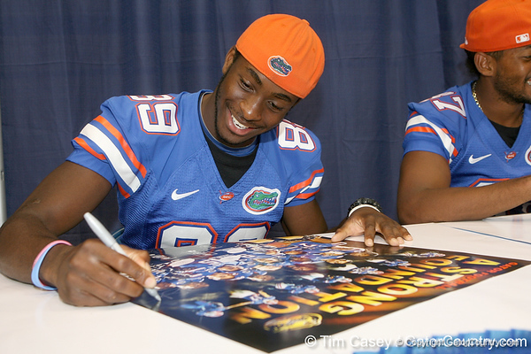 Florida redshirt freshman wide receiver Stephen Alli signs an autograph  during the Gators' annual Fan Day on Sunday, August 15, 2010 at the Stephen C. O'Connell Center in Gainesville, Fla. / Gator Country photo by Tim Casey
