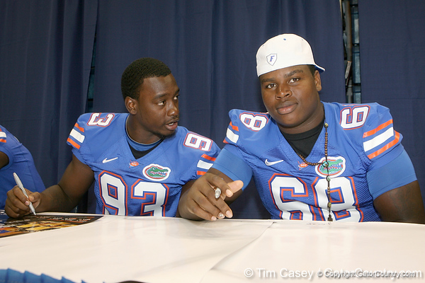 Florida redshirt freshman defensive end Kedric Johnson talks with freshman defensive tackle Leon Orr during the Gators' annual Fan Day on Sunday, August 15, 2010 at the Stephen C. O'Connell Center in Gainesville, Fla. / Gator Country photo by Tim Casey
