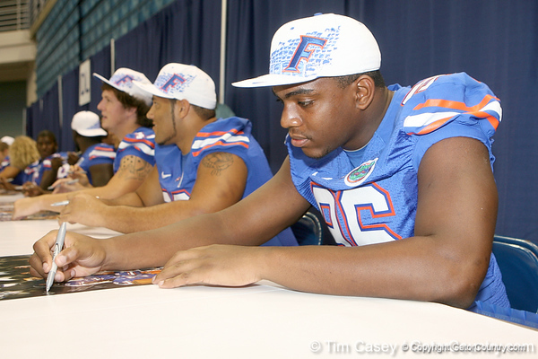 Florida junior defensive end William Green signs an autograph during the Gators' annual Fan Day on Sunday, August 15, 2010 at the Stephen C. O'Connell Center in Gainesville, Fla. / Gator Country photo by Tim Casey
