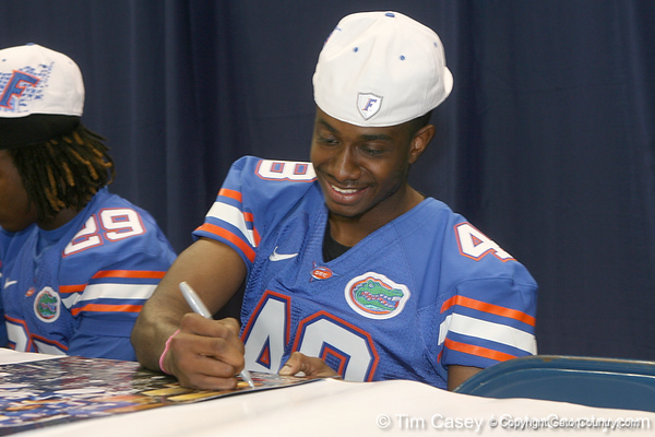 Florida redshirt sophomore cornerback Corey Henderson signs an autograph during the Gators' annual Fan Day on Sunday, August 15, 2010 at the Stephen C. O'Connell Center in Gainesville, Fla. / Gator Country photo by Tim Casey