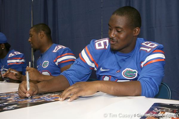 Florida redshirt senior linebacker A.J. Jones signs an autograph during the Gators' annual Fan Day on Sunday, August 15, 2010 at the Stephen C. O'Connell Center in Gainesville, Fla. / Gator Country photo by Tim Casey