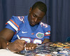 Florida freshman running back Mack Brown signs an autograph during the Gators' annual Fan Day on Sunday, August 15, 2010 at the Stephen C. O'Connell Center in Gainesville, Fla. / Gator Country photo by Tim Casey