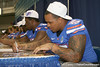 Florida senior center Mike Pouncey signs an autograph during the Gators' annual Fan Day on Sunday, August 15, 2010 at the Stephen C. O'Connell Center in Gainesville, Fla. / Gator Country photo by Tim Casey