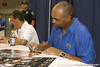 Florida defensive coordinator/ cornerbacks coach Teryl Austin signs an autograph during the Gators' annual Fan Day on Sunday, August 15, 2010 at the Stephen C. O'Connell Center in Gainesville, Fla. / Gator Country photo by Tim Casey