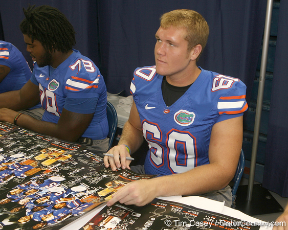 Florida junior offensive lineman William Steinmann signs an autograph during the Gators' annual Fan Day on Sunday, August 15, 2010 at the Stephen C. O'Connell Center in Gainesville, Fla. / Gator Country photo by Tim Casey