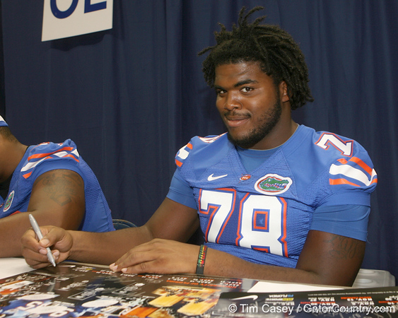 Florida redshirt sophomore offensive lineman David Young signs an autograph during the Gators' annual Fan Day on Sunday, August 15, 2010 at the Stephen C. O'Connell Center in Gainesville, Fla. / Gator Country photo by Tim Casey