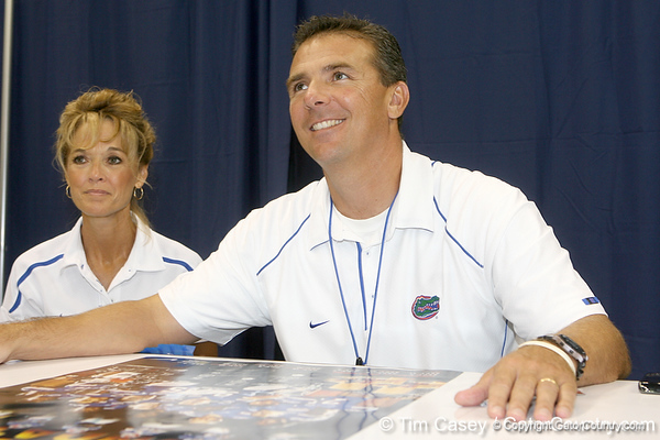 Florida head coach Urban Meyer talks with a fan during the Gators' annual Fan Day on Sunday, August 15, 2010 at the Stephen C. O'Connell Center in Gainesville, Fla. / Gator Country photo by Tim Casey