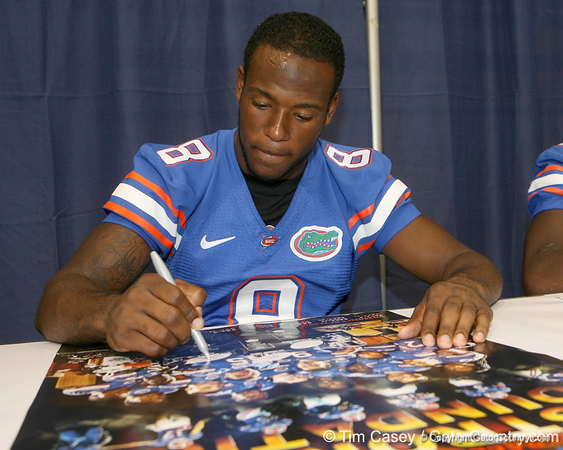 Florida freshman wide receiver Adrian Coxson signs an autograph during the Gators' annual Fan Day on Sunday, August 15, 2010 at the Stephen C. O'Connell Center in Gainesville, Fla. / Gator Country photo by Tim Casey