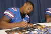 Florida freshman wide receiver Solomon Patton signs an autograph during the Gators' annual Fan Day on Sunday, August 15, 2010 at the Stephen C. O'Connell Center in Gainesville, Fla. / Gator Country photo by Tim Casey