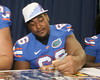 Florida redshirt junior offensive lineman James Wilson signs an autograph during the Gators' annual Fan Day on Sunday, August 15, 2010 at the Stephen C. O'Connell Center in Gainesville, Fla. / Gator Country photo by Tim Casey