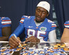 Florida freshman defensive end Lynden Trail signs an autograph during the Gators' annual Fan Day on Sunday, August 15, 2010 at the Stephen C. O'Connell Center in Gainesville, Fla. / Gator Country photo by Tim Casey