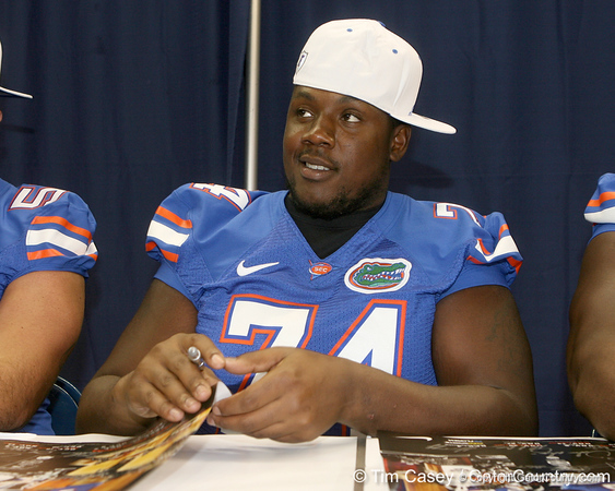 Florida redshirt senior offensive lineman Maurice Hurt signs an autograph during the Gators' annual Fan Day on Sunday, August 15, 2010 at the Stephen C. O'Connell Center in Gainesville, Fla. / Gator Country photo by Tim Casey
