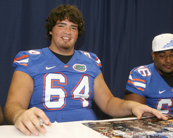 Florida redshirt freshman offensive lineman Kyle Koehne signs an autograph during the Gators' annual Fan Day on Sunday, August 15, 2010 at the Stephen C. O'Connell Center in Gainesville, Fla. / Gator Country photo by Tim Casey