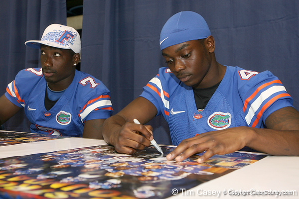 Florida redshirt freshman wide receiver Andre Debose signs an autograph during the Gators' annual Fan Day on Sunday, August 15, 2010 at the Stephen C. O'Connell Center in Gainesville, Fla. / Gator Country photo by Tim Casey