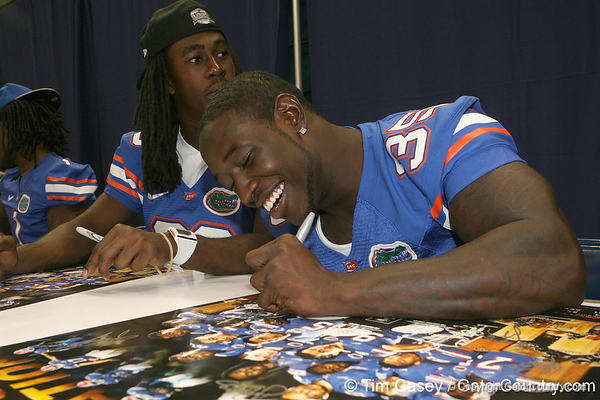 Florida senior safety Ahmad Black signs an autograph during the Gators' annual Fan Day on Sunday, August 15, 2010 at the Stephen C. O'Connell Center in Gainesville, Fla. / Gator Country photo by Tim Casey