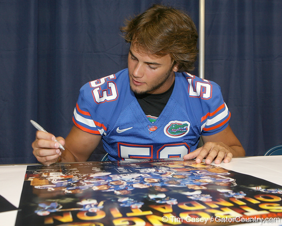 Florida redshirt sophomore linebacker Scott Peek signs an autograph during the Gators' annual Fan Day on Sunday, August 15, 2010 at the Stephen C. O'Connell Center in Gainesville, Fla. / Gator Country photo by Tim Casey