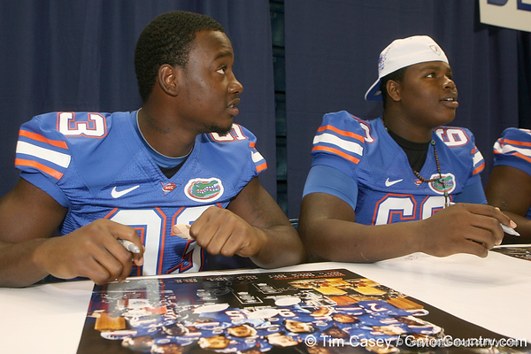 Florida redshirt freshman defensive end Kedric Johnson signs an autograph during the Gators' annual Fan Day on Sunday, August 15, 2010 at the Stephen C. O'Connell Center in Gainesville, Fla. / Gator Country photo by Tim Casey