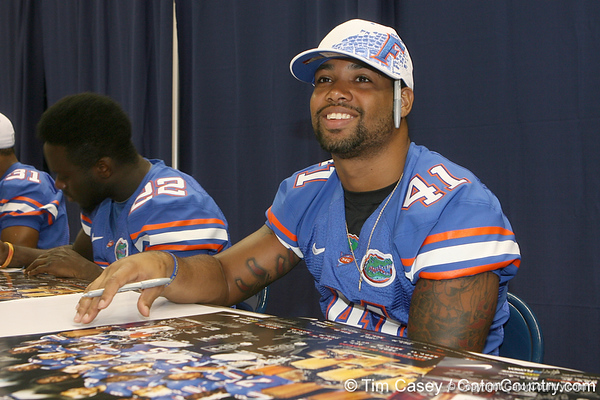 Florida redshirt senior safety Miguel Carodine signs an autograph during the Gators' annual Fan Day on Sunday, August 15, 2010 at the Stephen C. O'Connell Center in Gainesville, Fla. / Gator Country photo by Tim Casey