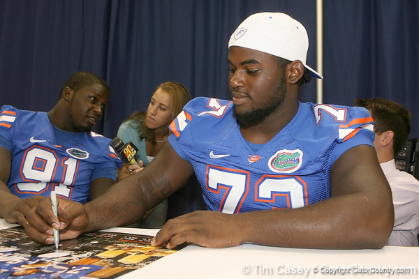 Florida freshman defensive tackle Sharrif Floyd signs an autograph during the Gators' annual Fan Day on Sunday, August 15, 2010 at the Stephen C. O'Connell Center in Gainesville, Fla. / Gator Country photo by Tim Casey