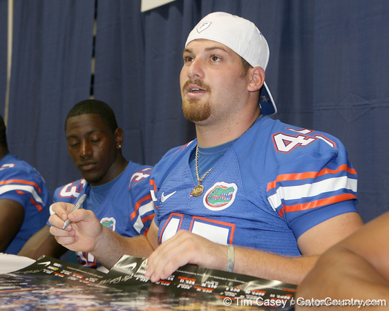 Florida redshirt sophomore fullback T.J. Pridemore talks to a fan during the Gators' annual Fan Day on Sunday, August 15, 2010 at the Stephen C. O'Connell Center in Gainesville, Fla. / Gator Country photo by Tim Casey