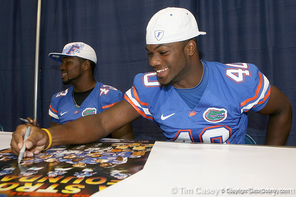 Florida senior linebacker Brandon Hicks signs an autograph during the Gators' annual Fan Day on Sunday, August 15, 2010 at the Stephen C. O'Connell Center in Gainesville, Fla. / Gator Country photo by Tim Casey