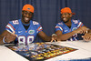 Florida redshirt freshman wide receiver Stephen Alli and redshirt sophomore wide receiver Josh Postell sign an autograph during the Gators' annual Fan Day on Sunday, August 15, 2010 at the Stephen C. O'Connell Center in Gainesville, Fla. / Gator Country photo by Tim Casey
