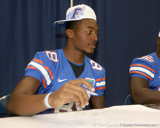 Florida freshman tight end Michael McFarland signs an autograph during the Gators' annual Fan Day on Sunday, August 15, 2010 at the Stephen C. O'Connell Center in Gainesville, Fla. / Gator Country photo by Tim Casey