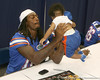 Florida junior safety Will Hill holds a baby during the Gators' annual Fan Day on Sunday, August 15, 2010 at the Stephen C. O'Connell Center in Gainesville, Fla. / Gator Country photo by Tim Casey