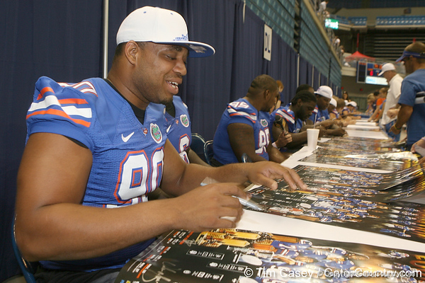 Florida redshirt senior Lawrence Marsh signs an autograph during the Gators' annual Fan Day on Sunday, August 15, 2010 at the Stephen C. O'Connell Center in Gainesville, Fla. / Gator Country photo by Tim Casey