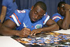 Florida junior running back Jeff Demps signs an autograph during the Gators' annual Fan Day on Sunday, August 15, 2010 at the Stephen C. O'Connell Center in Gainesville, Fla. / Gator Country photo by Tim Casey