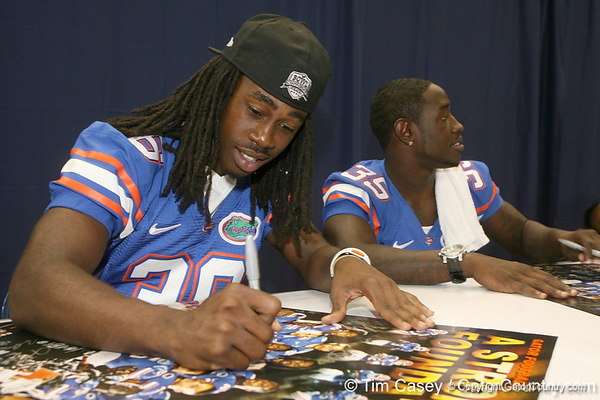 Florida senior cornerback Moses Jenkins signs an autograph during the Gators' annual Fan Day on Sunday, August 15, 2010 at the Stephen C. O'Connell Center in Gainesville, Fla. / Gator Country photo by Tim Casey