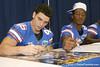 Florida redshirt sophomore fullback Michael Ross signs an autograph during the Gators' annual Fan Day on Sunday, August 15, 2010 at the Stephen C. O'Connell Center in Gainesville, Fla. / Gator Country photo by Tim Casey