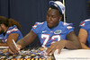 Florida redshirt freshman offensive lineman Jonotthan Harrison signs an autograph during the Gators' annual Fan Day on Sunday, August 15, 2010 at the Stephen C. O'Connell Center in Gainesville, Fla. / Gator Country photo by Tim Casey