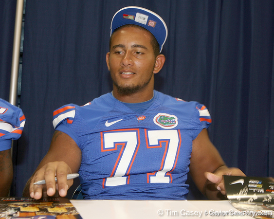 Florida freshman offensive lineman Ian Silberman signs an autograph during the Gators' annual Fan Day on Sunday, August 15, 2010 at the Stephen C. O'Connell Center in Gainesville, Fla. / Gator Country photo by Tim Casey