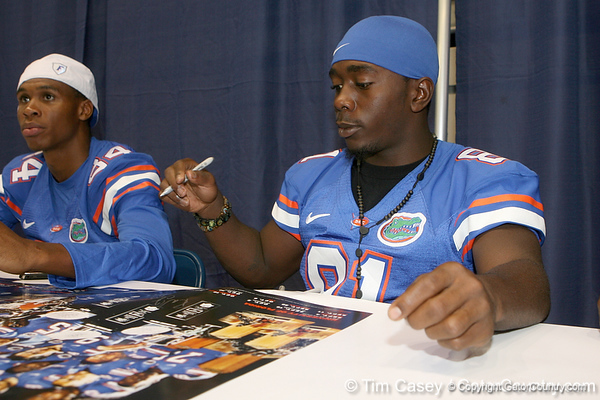 Florida freshman wide receiver Robert Clark signs an autograph during the Gators' annual Fan Day on Sunday, August 15, 2010 at the Stephen C. O'Connell Center in Gainesville, Fla. / Gator Country photo by Tim Casey