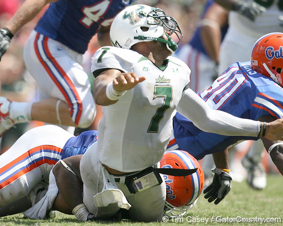 Florida senior linebacker Brandon Hicks tackles B.J. Daniels during the second half of the Gators' 38-14 win against the South Florida Bulls on Saturday, September 11, 2010 at Ben Hill Griffin Stadium in Gainesville, Fla. / Gator Country photo by Tim Casey