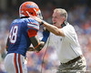 Florida freshman linebacker Neiron Ball gets congratulated by linebackers/ special teams coach D.J. Durkin after making a tackle on a kickoff during the second half of the Gators' 38-14 win against the South Florida Bulls on Saturday, September 11, 2010 at Ben Hill Griffin Stadium in Gainesville, Fla. / Gator Country photo by Tim Casey