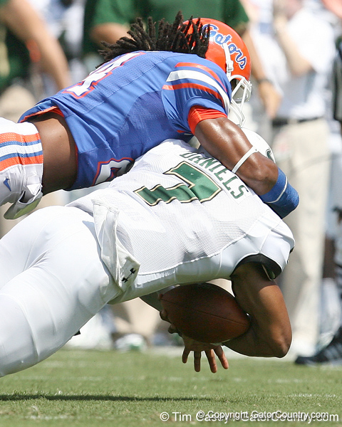 Florida sophomore free safety Josh Evans tackles B.J. Daniels during the first half of the Gators' game against the South Florida Bulls on Saturday, September 11, 2010 at Ben Hill Griffin Stadium in Gainesville, Fla. / Gator Country photo by Tim Casey