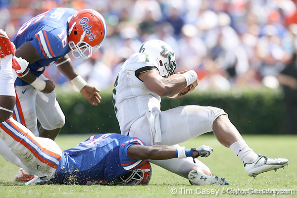 Florida freshman cornerback Jaylen Watkins tackles B.J. Daniels during the second half of the Gators' 38-14 win against the South Florida Bulls on Saturday, September 11, 2010 at Ben Hill Griffin Stadium in Gainesville, Fla. / Gator Country photo by Tim Casey