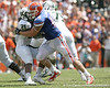 Florida senior defensive end Duke Lemmens tackles USF running back Demetri Murray for a three-yard loss during the second half of the Gators' 38-14 win against the Bulls on Saturday, September 11, 2010 at Ben Hill Griffin Stadium in Gainesville, Fla. / Gator Country photo by Tim Casey