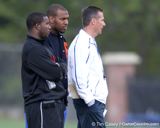 Dorian Munroe, Ryan Stamper and Urban Meyer look on during the Gators' first day of spring practice on Wednesday, March 17, 2010 at the Sanders football practice fields in Gainesville, Fla. / Gator Country photo by Tim Casey