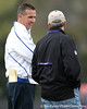 Florida head coach Urban Meyer talks to a Baltimore Ravens' coach during the Gators' first day of spring practice on Wednesday, March 17, 2010 at the Sanders football practice fields in Gainesville, Fla. / Gator Country photo by Tim Casey