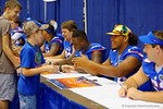 Florida OL Max Garcia greets a young fan during the 2014 Florida Gator Fan Day.  August 16th, 2014. Gator Country photo by David Bowie.