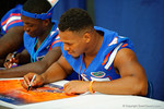 Florida Gator RB Mark Herndon signs a poster for a fan during the 2014 Florida Gator Fan Day.  August 16th, 2014. Gator Country photo by David Bowie.