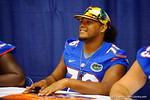 Florida Gator OL Max Garcia signs a poster for a fan during the 2014 Florida Gator Fan Day.  August 16th, 2014. Gator Country photo by David Bowie.