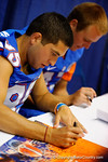 Florida Gator kicker Francisco Velez signs a poster for a fan during the 2014 Florida Gator Fan Day.  August 16th, 2014. Gator Country photo by David Bowie.